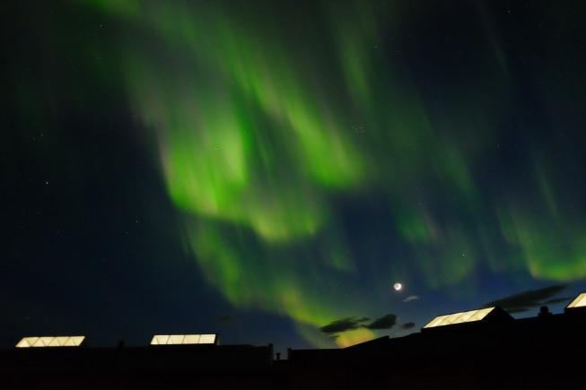 Northern Lights above Husafell: against the backdrop of snow-capped mountains surrounding our hotel